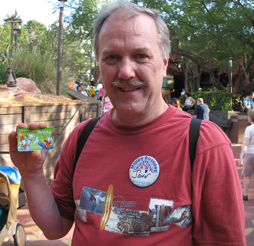 Dad shows off his Birthday Fastpass Card