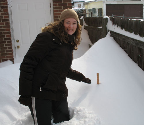 Amy stands next to a yardstick... yes, lots of snow!