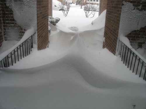 "Odd snowdrifts in the ""canyon"" between condo buildings"
