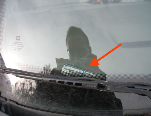 February 16: Sticker has fallen off window onto dashboard