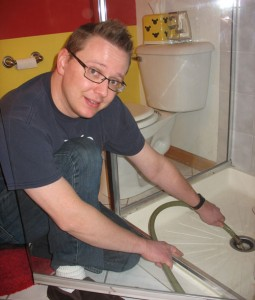 Steve drains the old tank into our 2nd bathroom shower