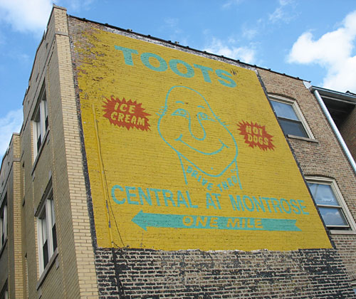 Toots sign painted on apartment building