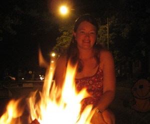 Amy makes s'mores in the street